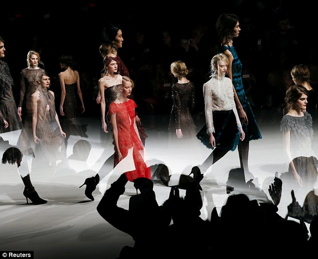 A stylish event: Models stomp down the runway in the latest ware from Shoji's collection