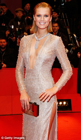 Golden girl: Toni's dress was almost boucle and it showed off plenty of skin - both legs and chest