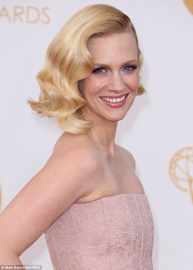 Spot the difference? January Jones is pictured here at the Emmy Awards in September of 2013 with near-perfect hair, many years on