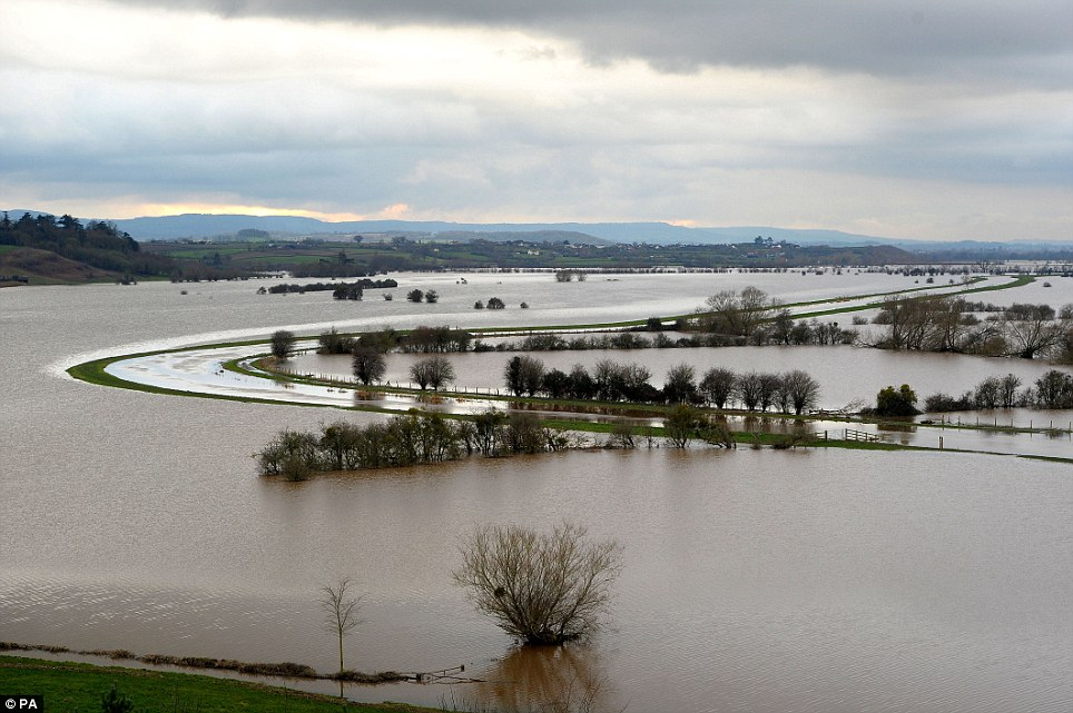 Flooded fields around the River Tone: This winter's almost unprecedented deluge has, of course, focused many minds on the fate of the Somerset Levels