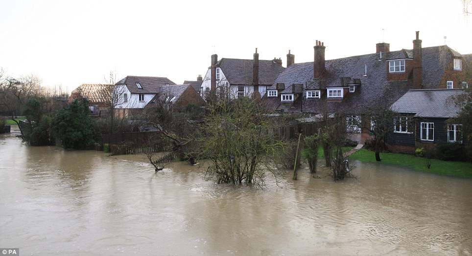 Pricey: It was recently estimated that flood defences for the river Beult near Yalding in Kent (pictured), plus improvements to the local reservoir, will cost £50million