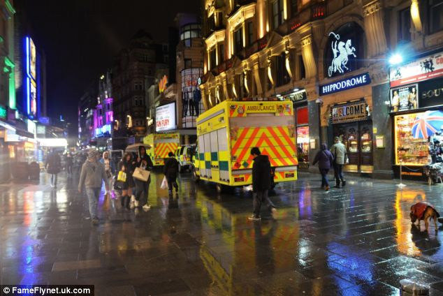 Emergency response teams line up in Leicester Square after a body, believed to be that of missing Irish student Patrick Halpin, was found nearby
