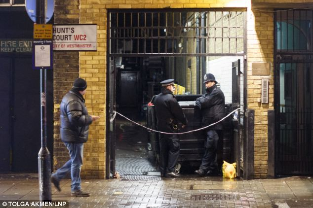 Scene: A body was found at around 7.50pm last night in an enclosed area (pictured) between Zoo Bar, where Mr Halpin had spent the evening, and a nearby Burger King