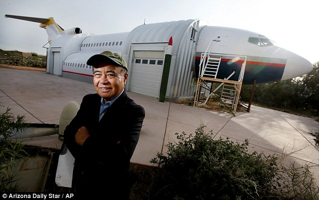 Architect, engineer, pilot: Toshikazu Tsukii in front of the guesthouse he crafted from the parts of three different planes