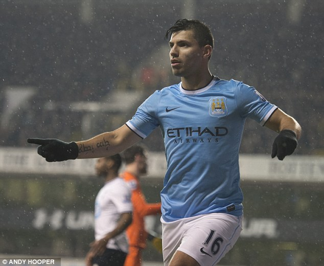 The great entertainers: Sergio Aguero celebrates his goal in the 5-1 win at Tottenham. City scored 14 goals in their four league victories