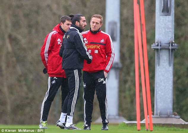 Talking to? New Swansea head coahc Garry Monk has a word with Chico at training on Thursday
