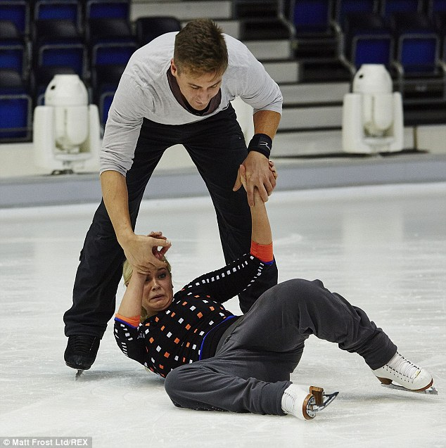 Pulling a face: Suzanne Shaw pulls a rather uncomfortable face as Matt kindly helps her onto her feet