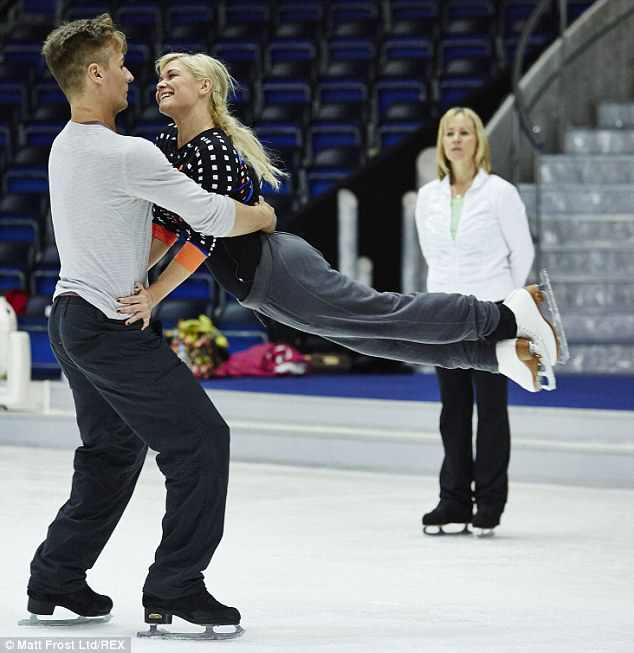 Comfortable together: Suzanne held onto Matt's waist as she was swung horizontally in the air