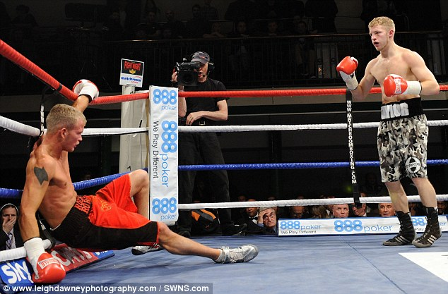 Beaten: Boxer Robin Deakin collapses in the ring as he is defeated by Ryan Taylor (right) in London. Robin has lost 50 fights in a row and is thought to be Britain's worst boxer