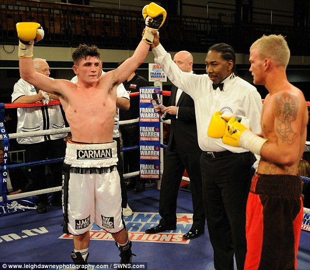 Victory: George Michael Carman holds his arms aloft after defeating Deakin on points in December 2011