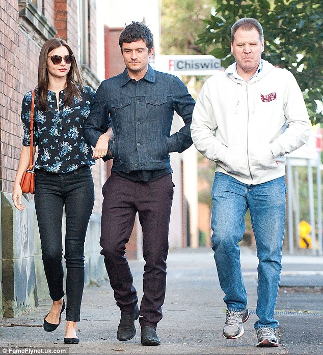 Breaking the news: Miranda's father John, pictured here with Miranda and Orlando in August 2012, says it was the actor who confirmed the news of the couple's separation last year, over the telephone