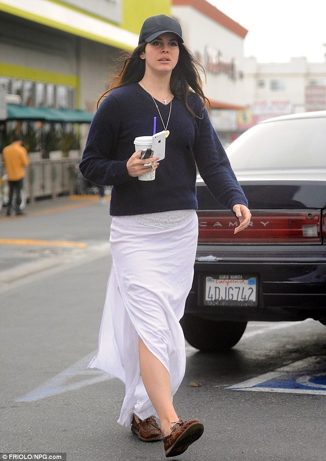Dressed down: Lana wore a white skirt and long sleeved top