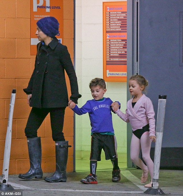 'Kids are so precious that your priorities change completely': As they entered the car-park, the former Fashion Star mentor's tiny dancer was still dressed in a leotard for her ballet class
