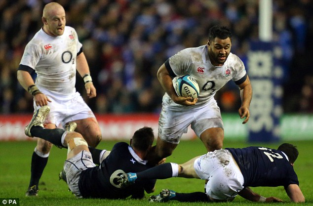 All ends up: England's Billy Vunipola barges past Scotland's Chris Fusaro