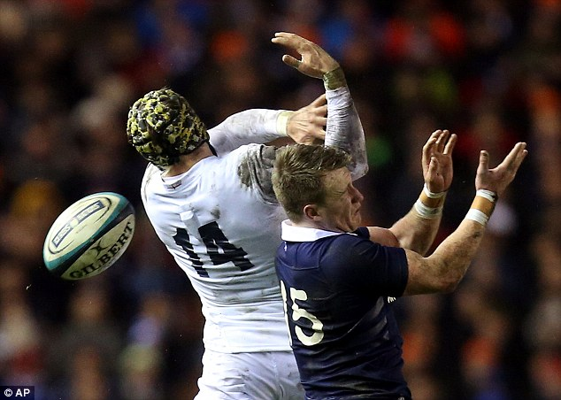 Out of grip: England's Jack Nowell cant catch the ball under pressure from Scotland's Stuart Hogg