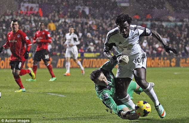 Great challenge: Cardiff keeper David Marshall makes a vital interception with Wilfried Bony through on goal