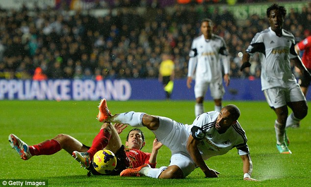 Sliding in: Ashley Williams and Peter Whittingham contest the 50/50