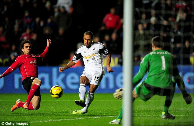 Opener: Wayne Routledge scores for Swansea just two minutes after the break