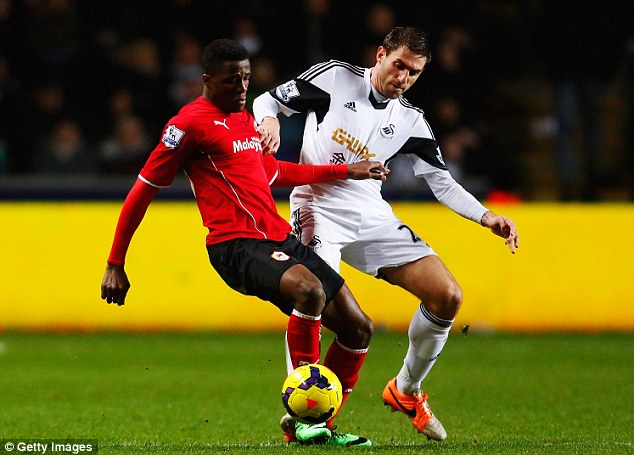Shield: Wilfried Zaha - on loan from Manchester United - holds off Swansea defender Angel Rangel