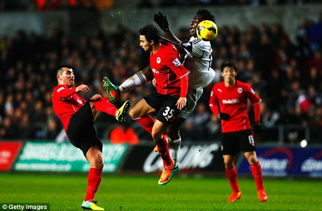 Up in the air: Fabio da Silva and Bony challenge for the high ball