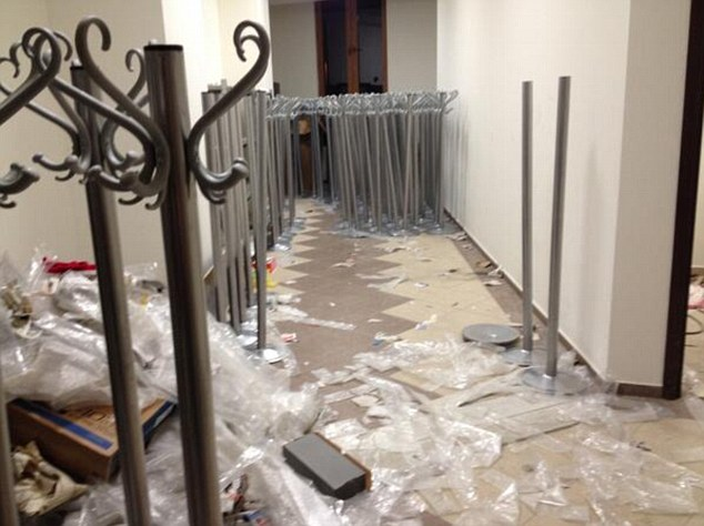 Shambles: A hotel corridor is left impassable in Sochi. Many of the hotels are palpably unfinished