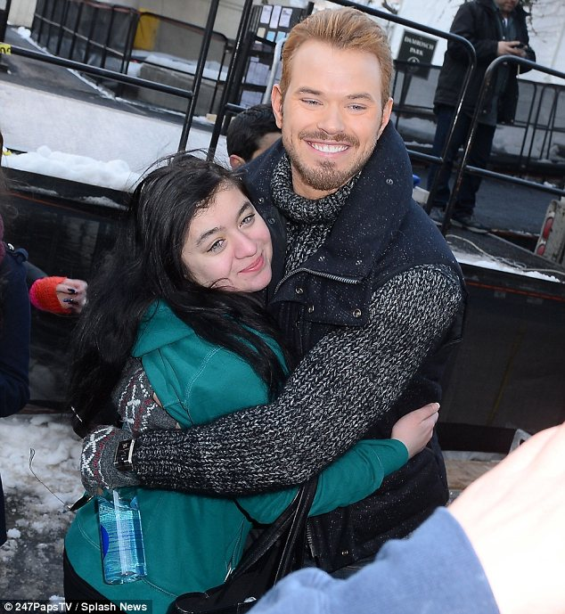 Fan frenzy: Kelly was approached by fans as he left the show in New York