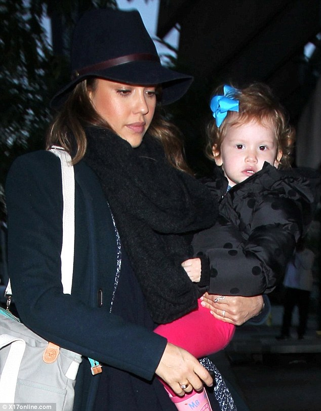 Hats off to her: Jessica Alba looked suitably smart in her wide-brimmed hat and chunky scarf