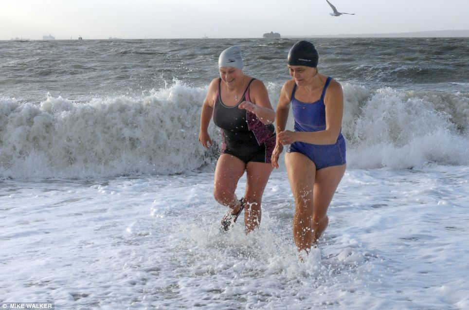 The rough seas and gale forced wids didn't deter Jane Kerr and Jan Clare from taking their daily dip at Southsea, Hampshire