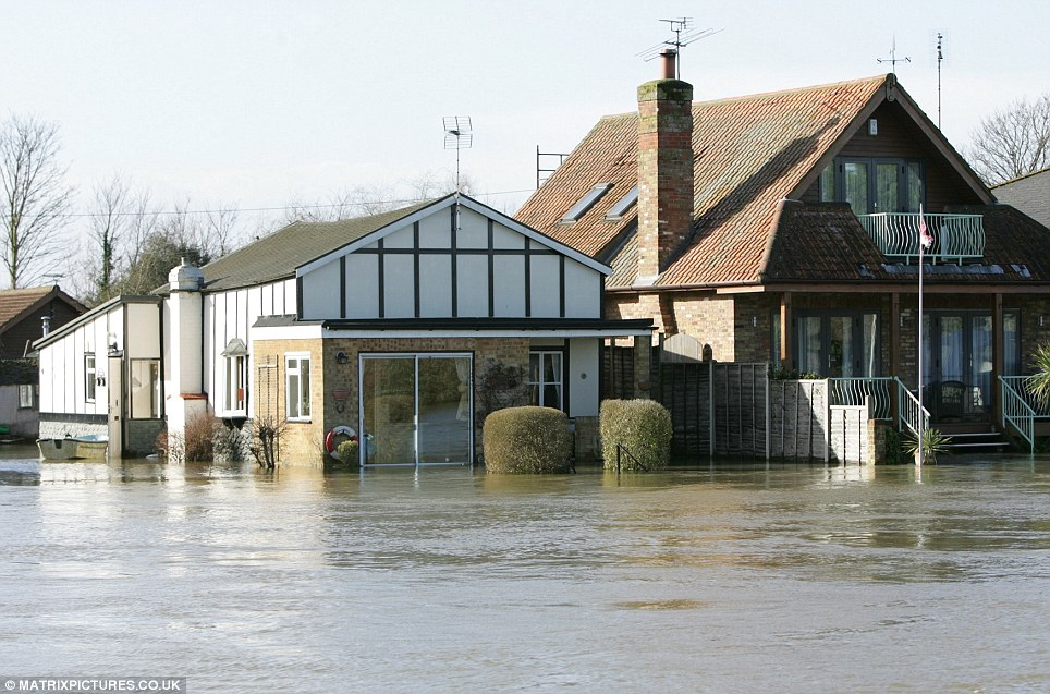 Gardens in Chertsey, Surrey, are no longer visible as the town is ravaged by flood water