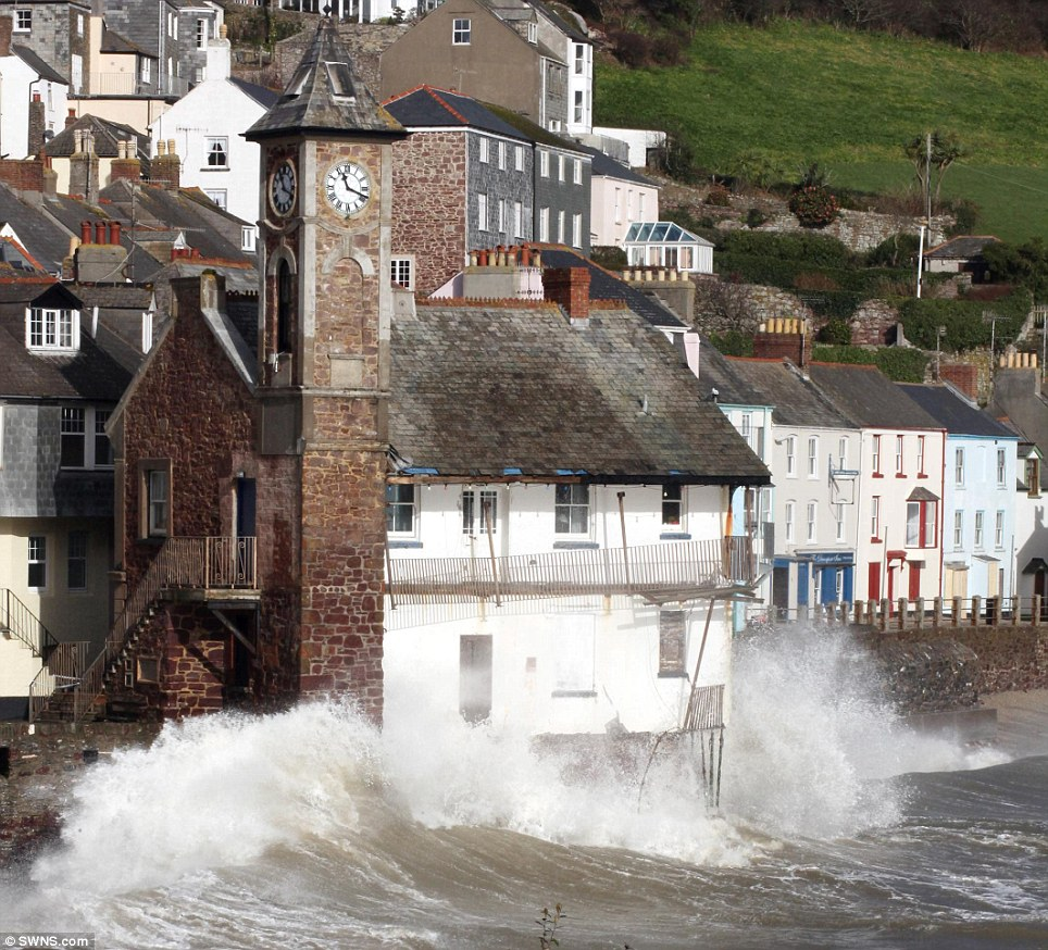 The famous clock tower of the coastal village of Kingsand, Cornwall bears the brunt of wind and wave as high tide arrives