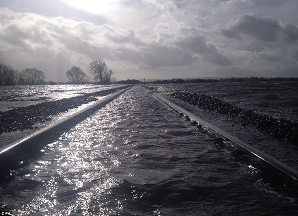 Under water: Network Rail issued this image of a flooded rail line in Bridgwater, Somerset