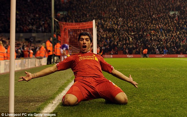 Danger man: Luis Suarez will be gunning for Arsenal on Saturday lunchtime as the Premier League leaders travel to Anfield