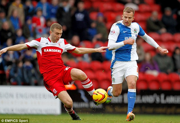 Balancing act: Middlesbrough's Ben Gibson (L) nips in to keep the ball from Blackburn Rovers' Jordan Rhodes