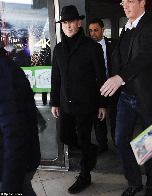 Flash: Pierce Brosnan looked smart in a navy blue jacket, matching fedora and black chord trousers with casual shoes
