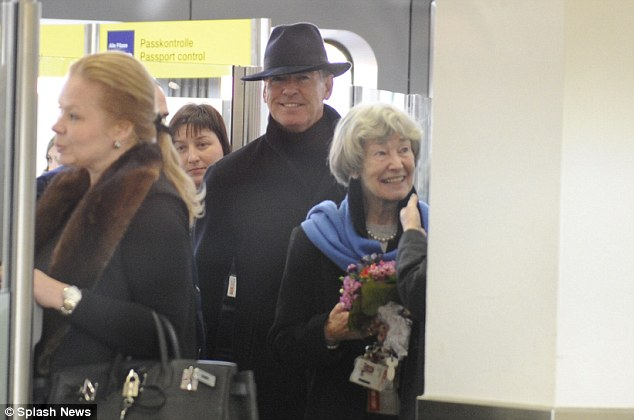 Good times: Pierce's mother Mary May Smith (right) looked delighted to be accompanying her son on the trip