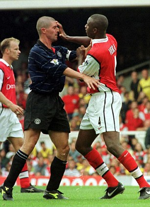 Best of enemies: Roy Keane (left) gets to grips with midfield nemesis Patrick Vieira in 1999