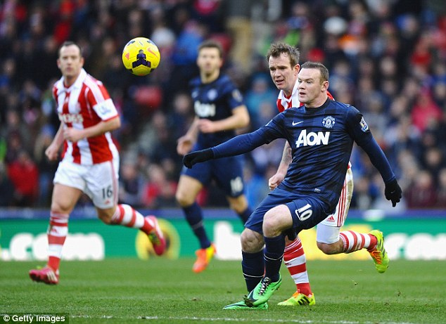Undecided: Wayne Rooney is yet to sign a new contract at Manchester United