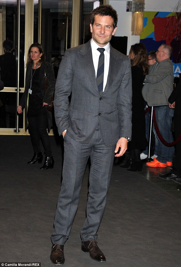 Dashing: Bradley Cooper also attended the premiere, looking every inch the Hollywood hunk he is in a grey suit, white shirt and navy and a grey tie