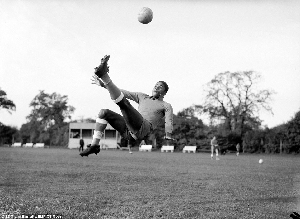 Portugal's Eusebio demonstrates an overhead kick during training