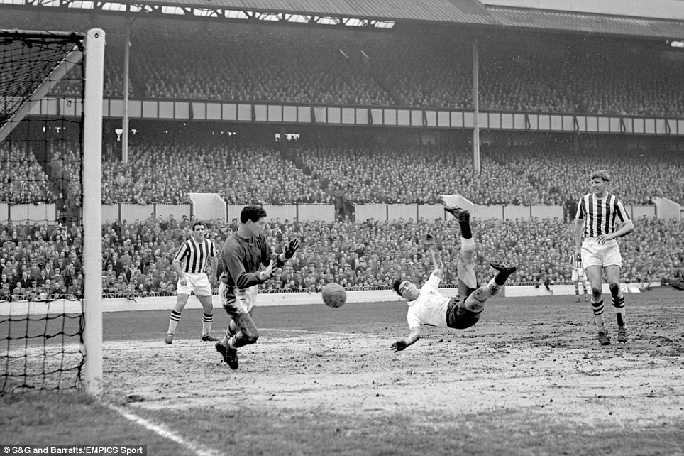 Tottenham Hotspur's Bobby Smith (second r) scores the second goal of his hat trick with a perfectly executed overhead kick past West Bromwich Albion goalkeeper Ray Potter (second l)