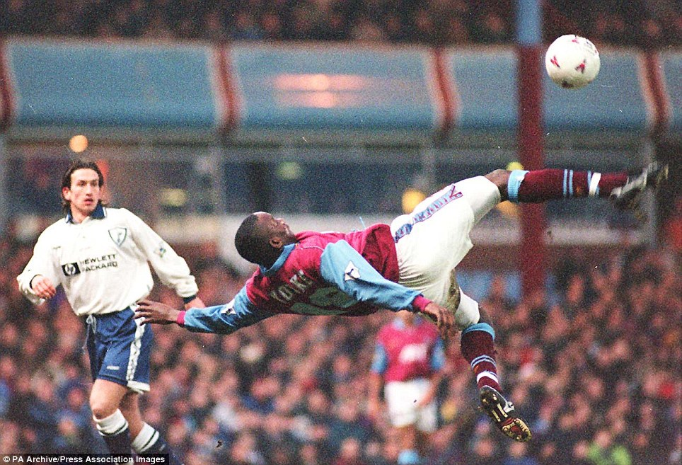 Aston Villa's Dwight Yorke lines up an overhead goal attempt during a Premiership clash against Tottenham at Villa Park