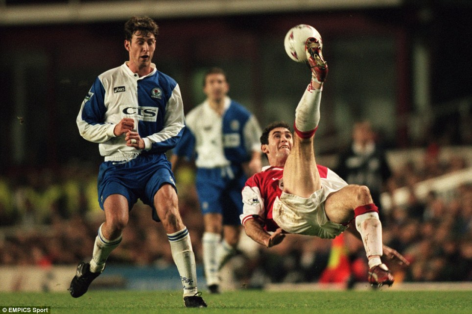 Arsenal's Martin Keown (right) clears from Blackburn Rovers' Chris Sutton (left) with an overhead kick