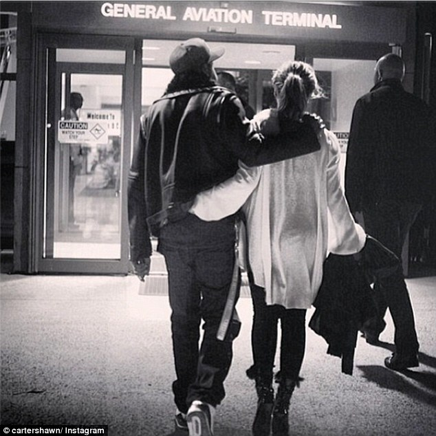 Back home: Jay-Z posted a photo of himself heading to the airport with Beyonce