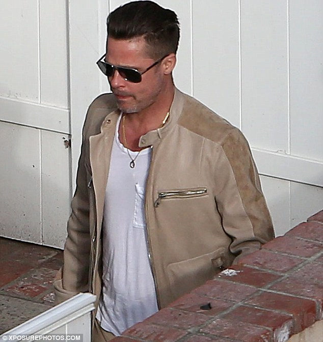 Accessories: The Mr. and Mrs. Smith actor wore a gold necklace that appeared to be the David Procop designed bauble his partner Angelina Jolie gave him