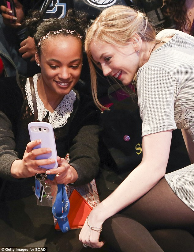 Fan time! Emily made time to pose for a selfie with a devotee at the event