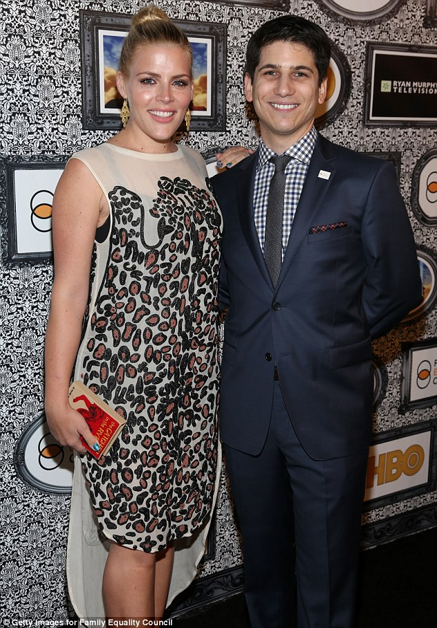 A-plus for daring: Busy, who was pictured with Family Equality Council's Gabriel Blau, added cool blue nail polish and golden earrings