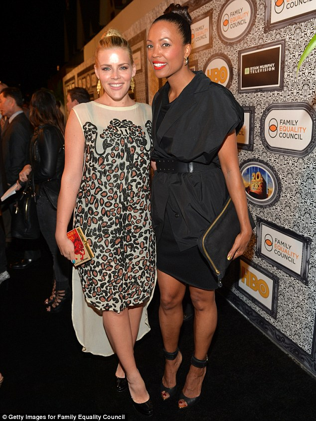All knotted up: The Cougar Town star posed with actress Aisha Tyler who wore her hair in a very similar topknot