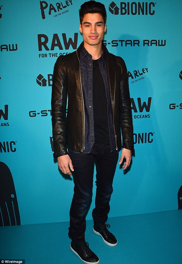 More denim: The Wanted's Siva Kaneswaran opted for dark wash jeans, an unbuttoned jean top and a leather jacket