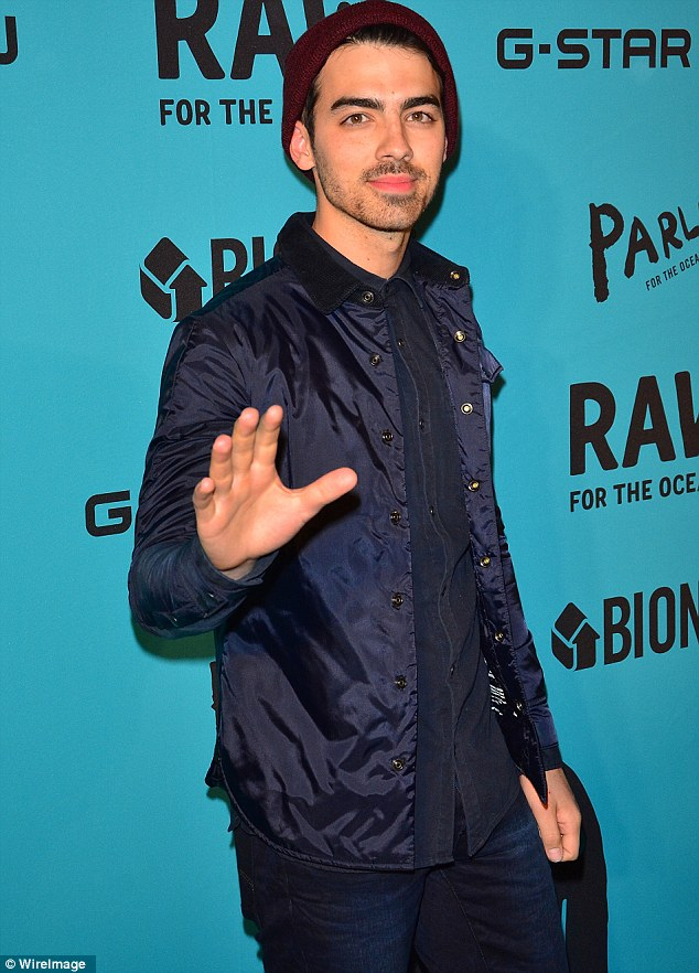 Monochromatic: Joe Jonas also made an appearance in dark wash jean pants and a nearly identically coloured top