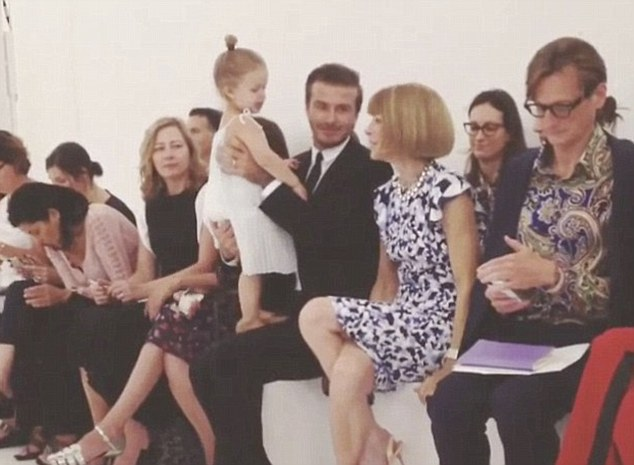 Mini me: Harper was perfectly behaved at September's fashion show, even impressing notoriously stoney-faced Anna